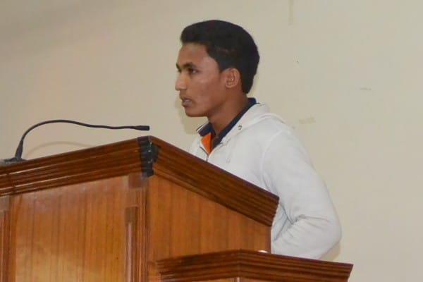 This is a photo of Samar last year giving his testimony in church.