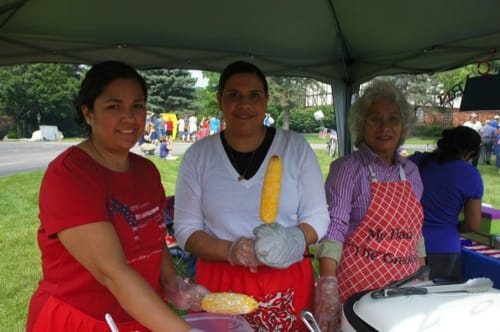 Ladies serving Mexican corn on the Cobb at the Taste of Fairhaven